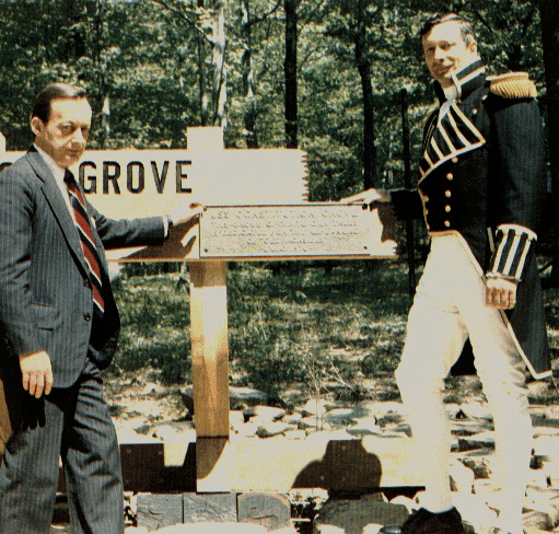 "H. Robert Freneau Secretary of the Navy Special Assistant [left] and CDR Tyrone G. Martin of USS Constitution dedicate the ceremonial ""Constitution Grove"" at NAVFAC Crane, IN, May 8, 1976. [Courtesy U.S. Navy]"
