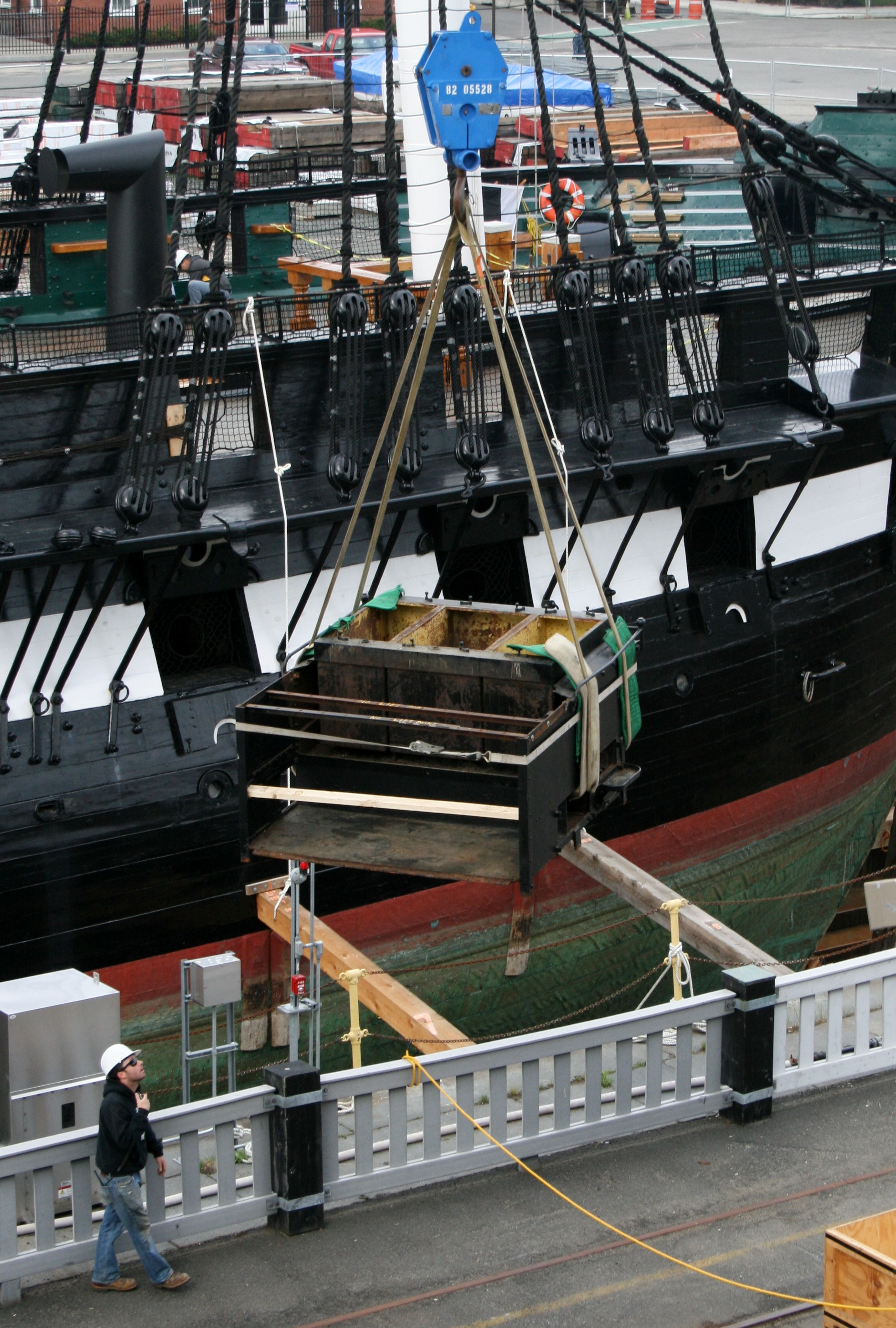 "The ""camboose,"" weighing 5,300 pounds, is lowered onto Pier 2, June 3, 2015. [Courtesy Naval History & Heritage Command Detachment Boston]"