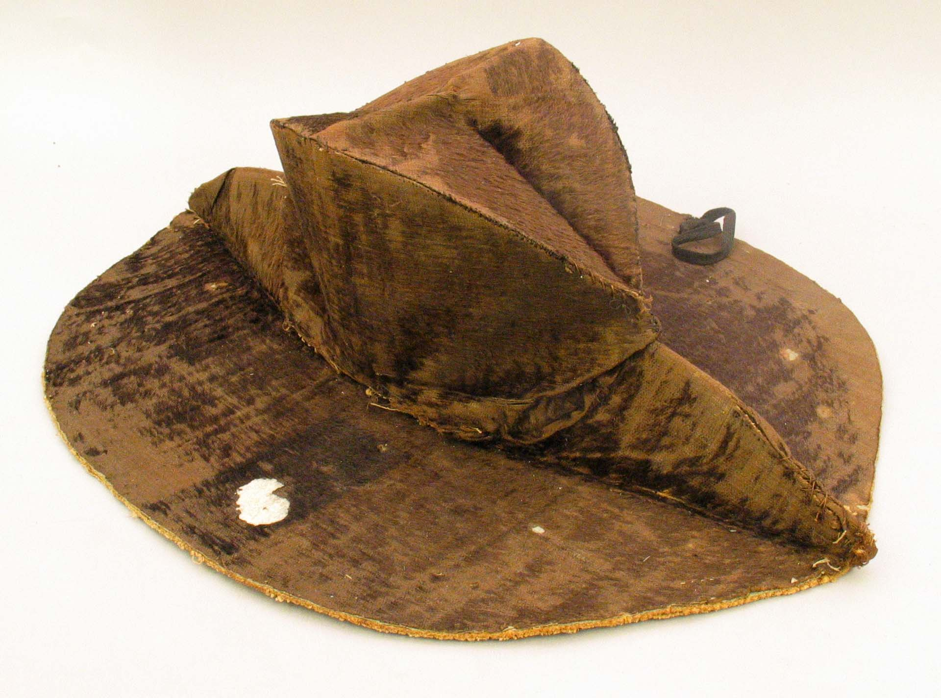 The interior of Whipple's hat, showing the complex construction that allowed the hat to fold flat when not worn. USS Constitution Museum.