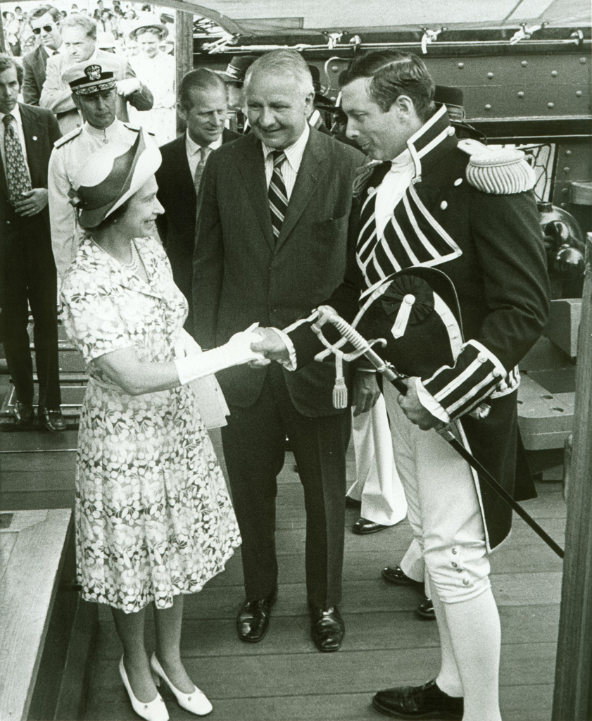 Commanding Officer Tyrone G. Martin welcomed Queen Elizabeth II aboard USS Constitution, along with Secretary of the Navy J. William Middendorf (center) and Prince Philip (background), on July 11, 1976. [Courtesy U.S. Navy]