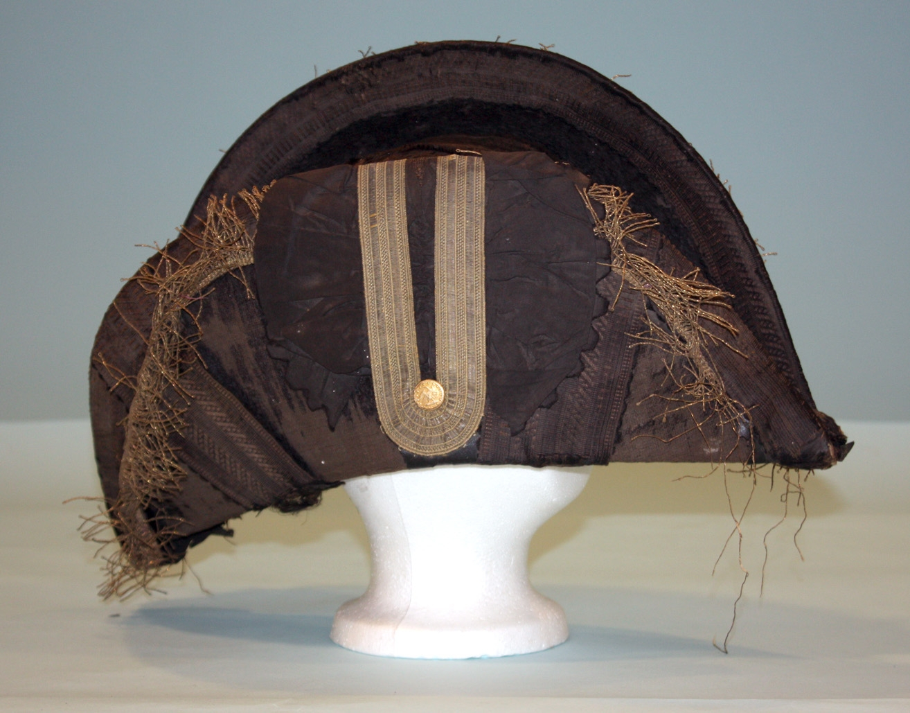 "A midshipman's or sailing master's cocked hat of 1820-1830, demonstrating how Whipple's hat would have looked when fully trimmed. Note that the gold fringe hanging from the brim was probably added in the late 19th or early 20th century when the hat was worn as a costume at a ""fancy dress"" party. US Naval Academy Museum, Annapolis."