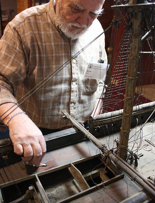 Bruce Bent, a longtime member of the USS Constitution Model Shipwright Guild of New England, helps spit clean the spar deck in 2013. [Courtesy USS Constitution Museum]