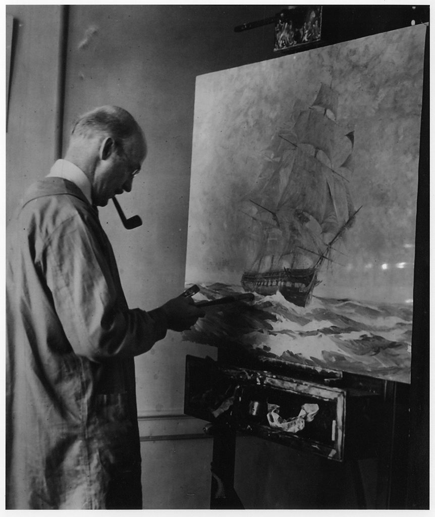 "Gordon Grant giving the final touches to his painting of ""Old Ironsides"" before presenting it to the White House. [Source unknown]"