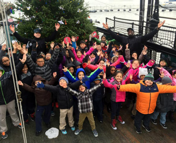 CHARLESTOWN, Mass. (Dec. 12, 2014) USS Constitution Sailors are joined by Charlestown-area schoolchildren to adorn Old Ironsides' 2014 Christmas tree with hand-made ornaments. (U.S. Navy photo by Religious Programs Specialist 2nd Class Dennis Lopez/Released)